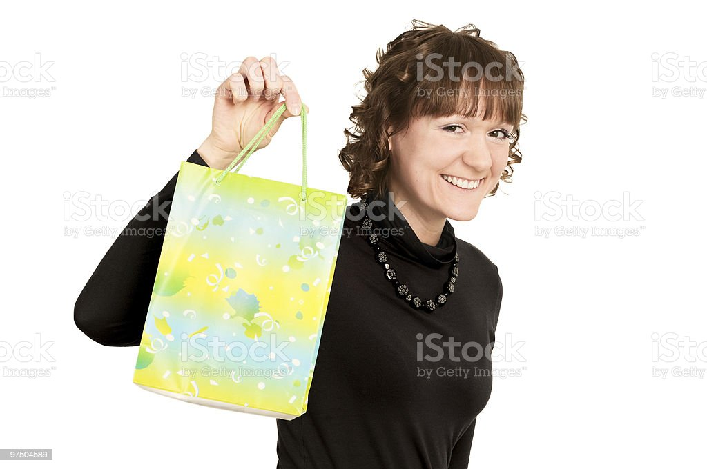 smiling girl buyer with present bag royalty-free stock photo