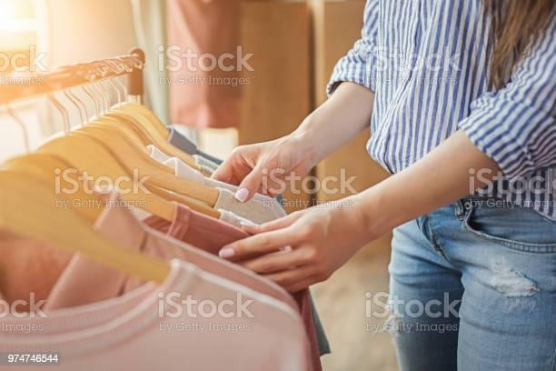 Smiling girl bying clothes in showroom picture id974746544?b=1&k=6&m=974746544&s=612x612&h=koymnw0dxwqenu 3y3jxuunjksg5t3yr89b2luyrcgu=