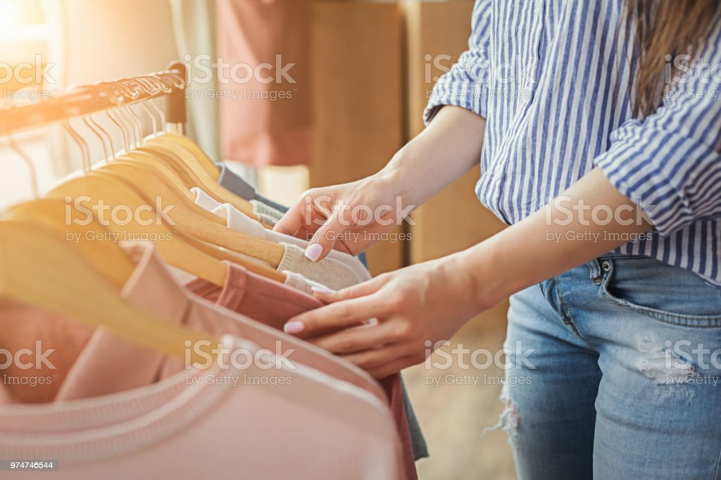 Smiling girl bying clothes in showroom stock photo