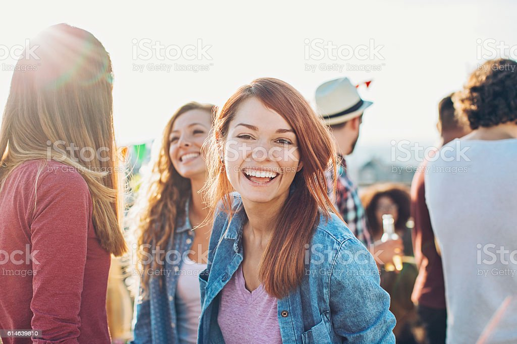 Smiling girl celebrating with friends stock photo