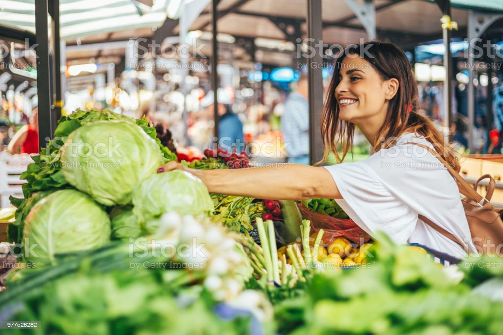 Smiling girl decided to cook a delicious and healthy meal stock photo