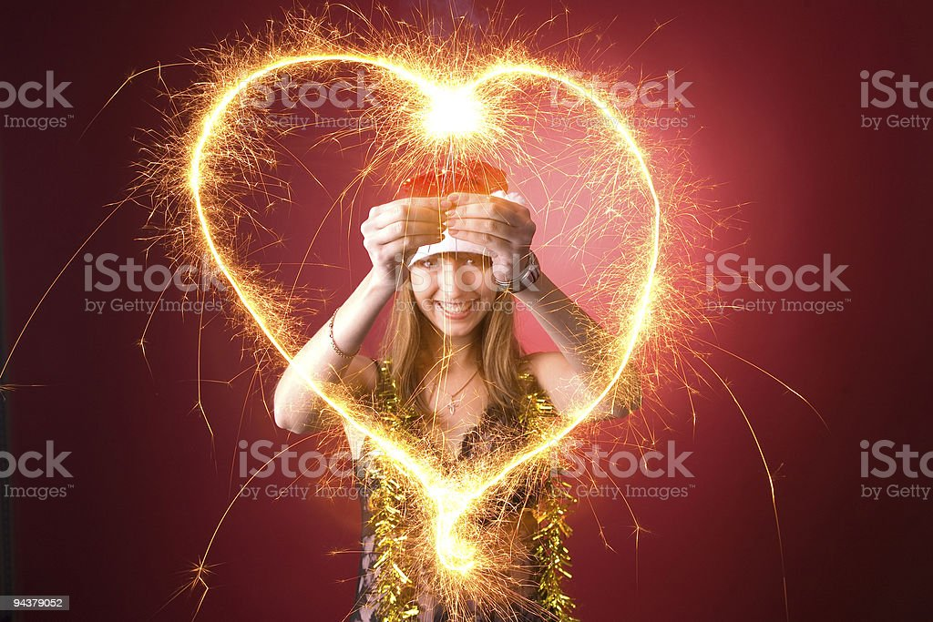 Smiling girl drawing heart royalty-free stock photo