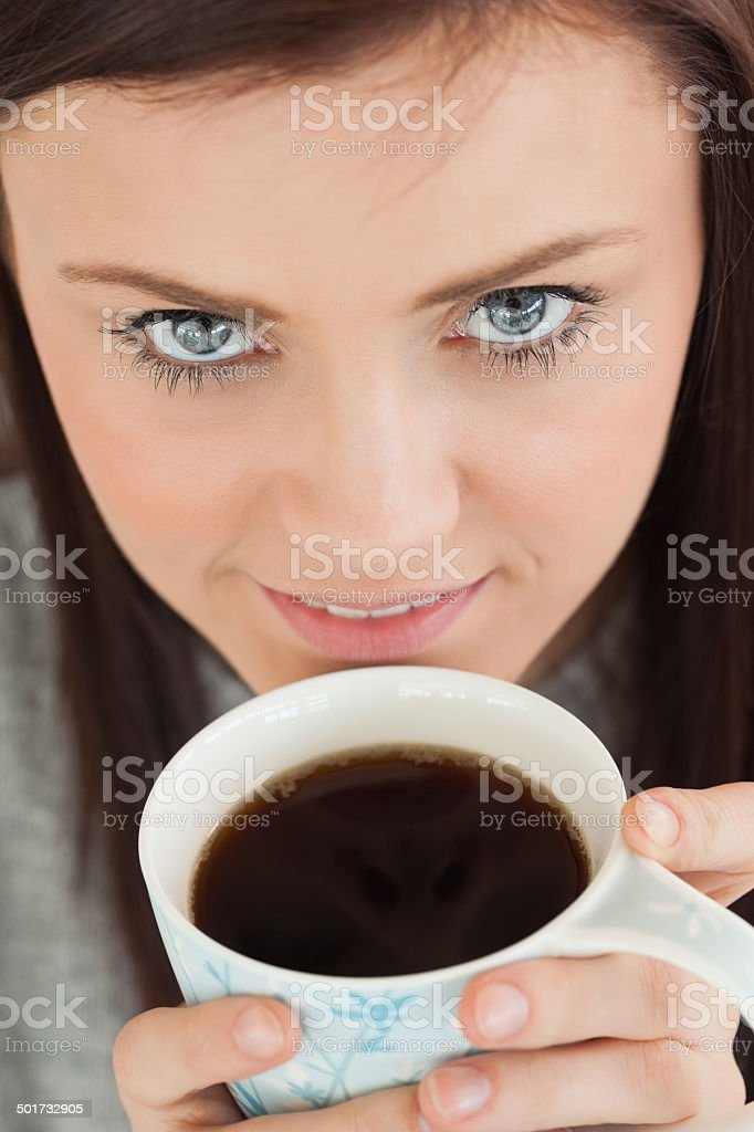 Smiling girl drinking a cup of coffee royalty-free stock photo