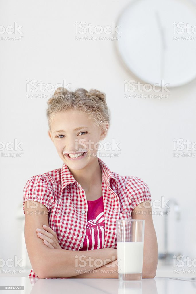 Smiling girl drinking glass of milk royalty-free stock photo