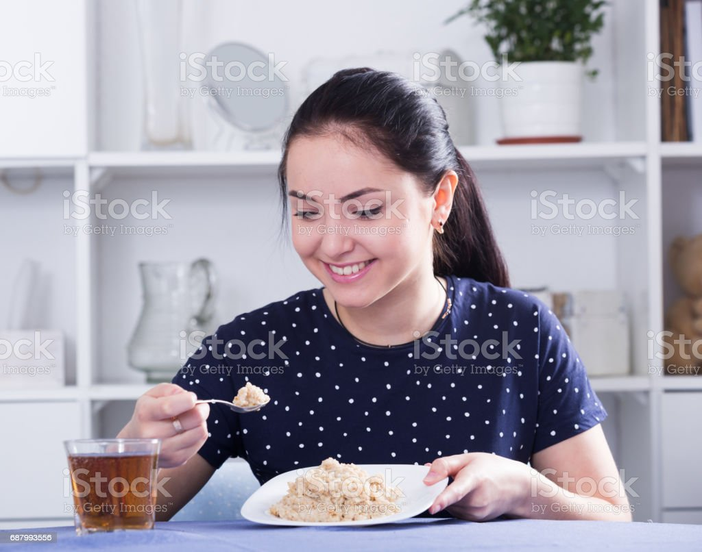 Smiling girl eating cereal stock photo