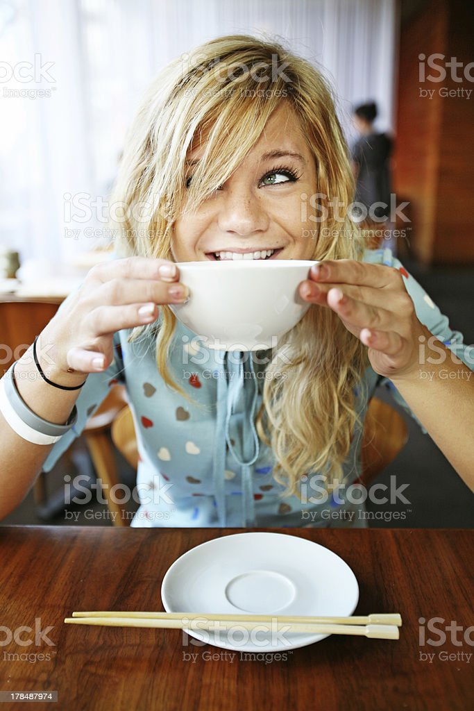 Smiling Girl Eating Miso Soup stock photo