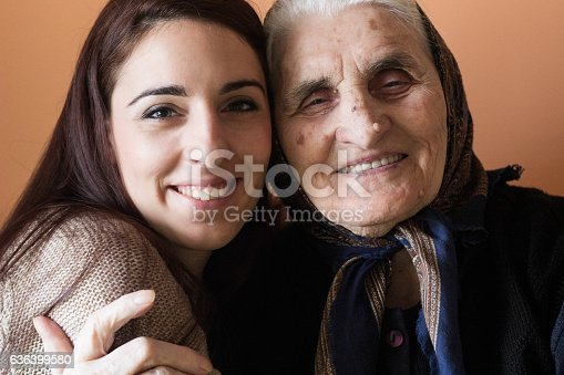 144362548istockphoto Smiling girl embracing her lovely grandmother 636399580