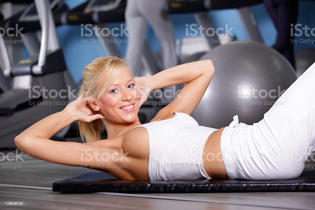 Smiling Girl Exercise in the Gym stock photo