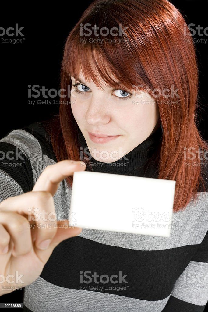 Smiling girl holding a blank card stock photo