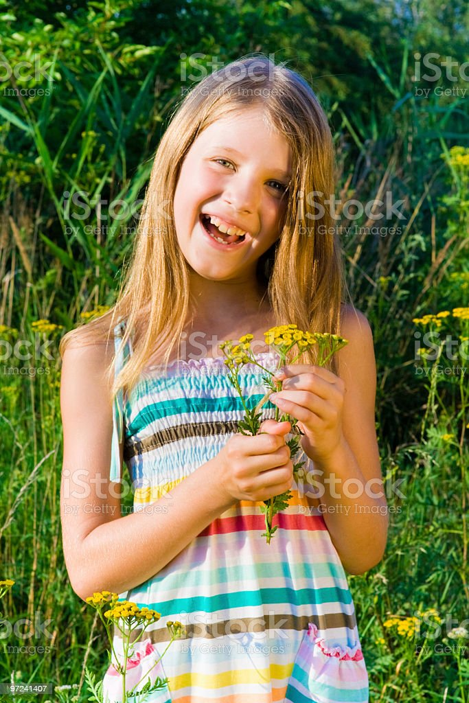 Smiling girl holding flowers royalty-free stock photo