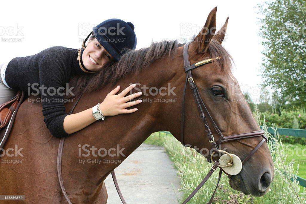 Smiling girl hugging her horse, Norway stock photo