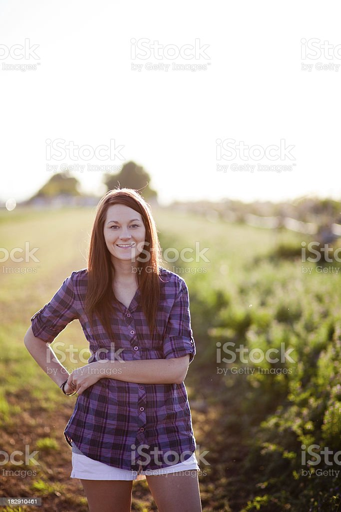 Smiling girl in a field. stock photo