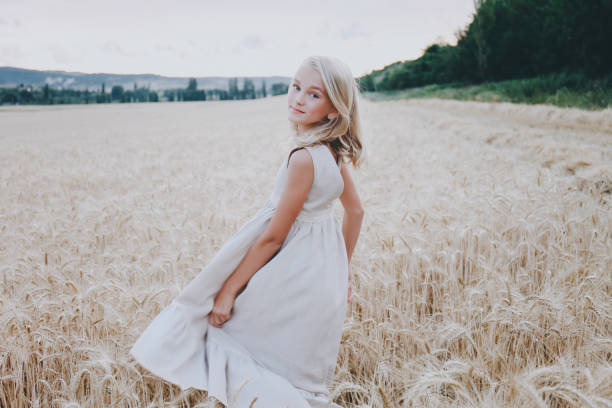 Smiling girl in a wheat field. stock photo