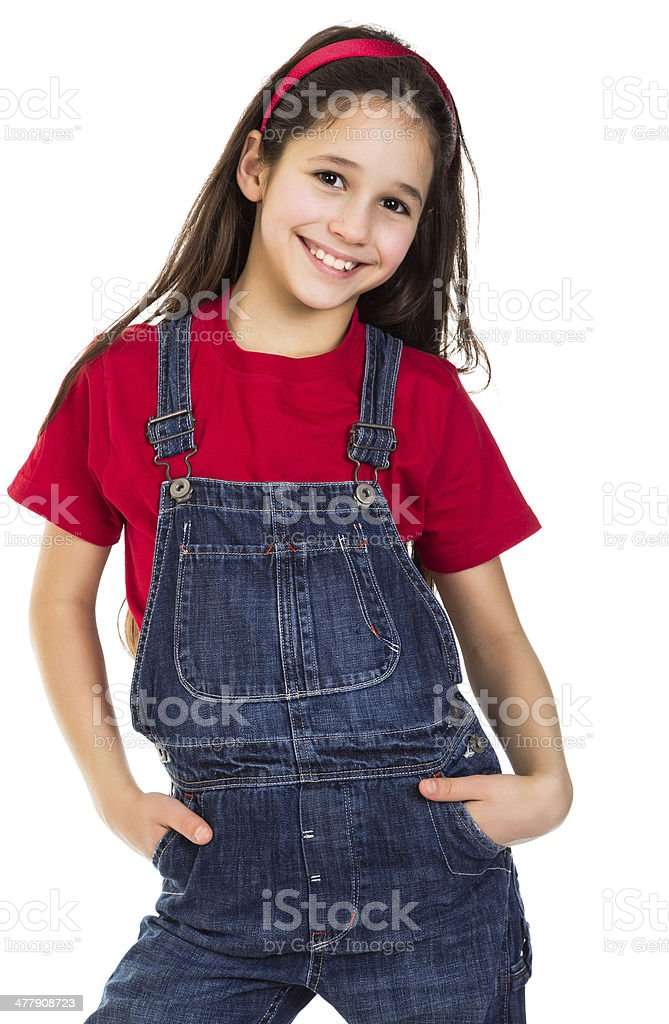 Smiling girl in coveralls stock photo