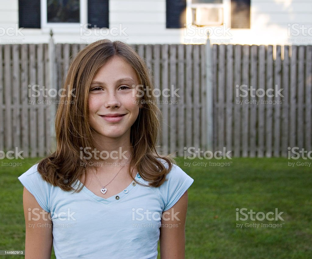 Smiling Girl in front of her house royalty-free stock photo