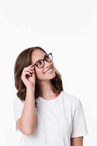 istock Smiling girl in glasses 1089633398