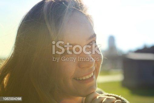 istock Smiling Girl in Park 1052004268