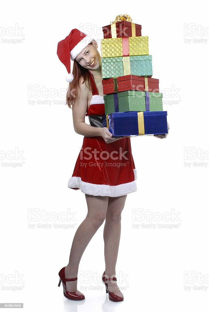 Smiling girl in santa dress with gifts royalty-free stock photo