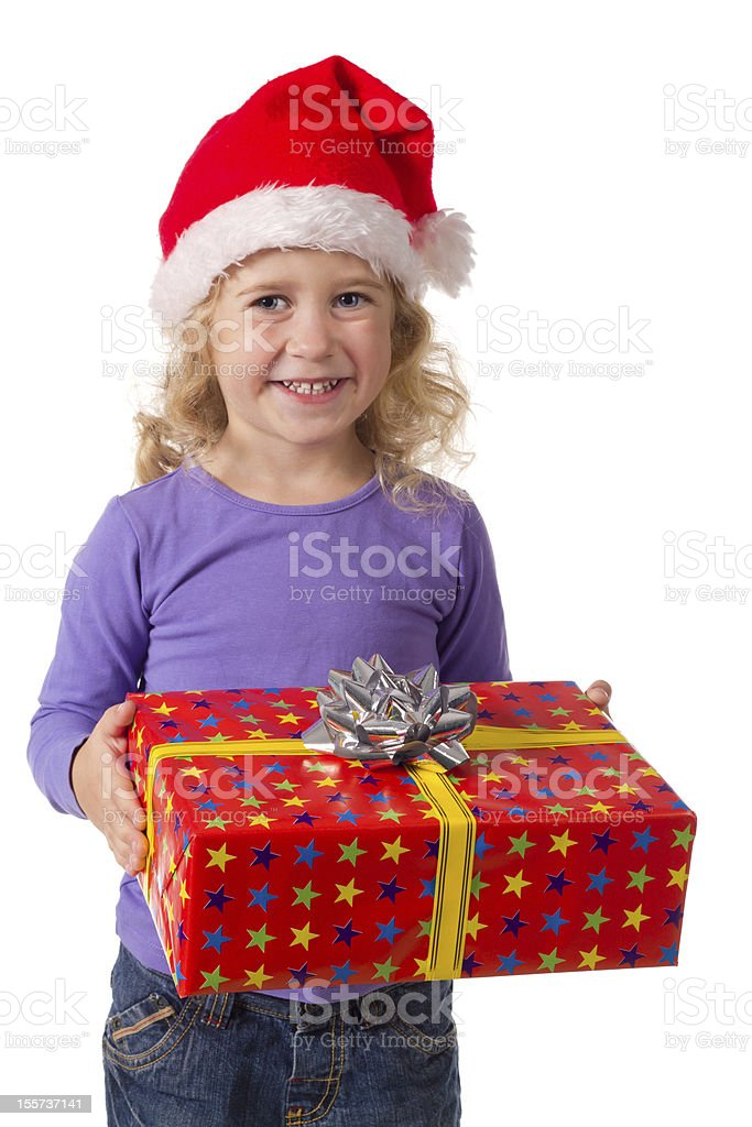 Smiling girl in Santa hat with gift box royalty-free stock photo