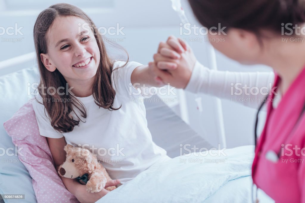 Smiling girl in the hospital stock photo