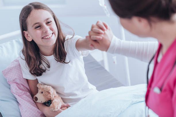 smiling girl in the hospital - cancer patient stock pictures, royalty-free photos & images