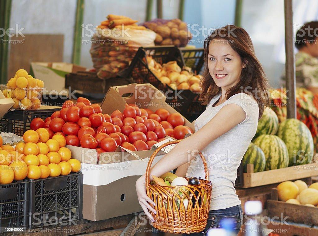smiling girl in the market stock photo