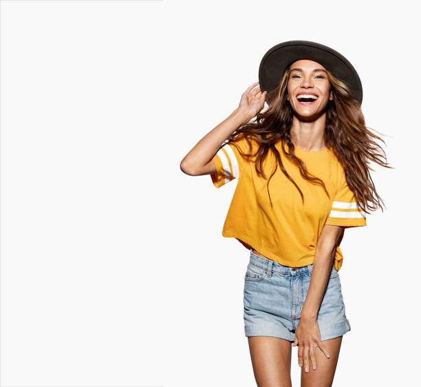 Smiling girl in trendy clothes posing at studio. stock photo