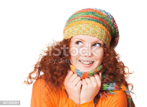 istock Smiling girl in warm clothing 467305051