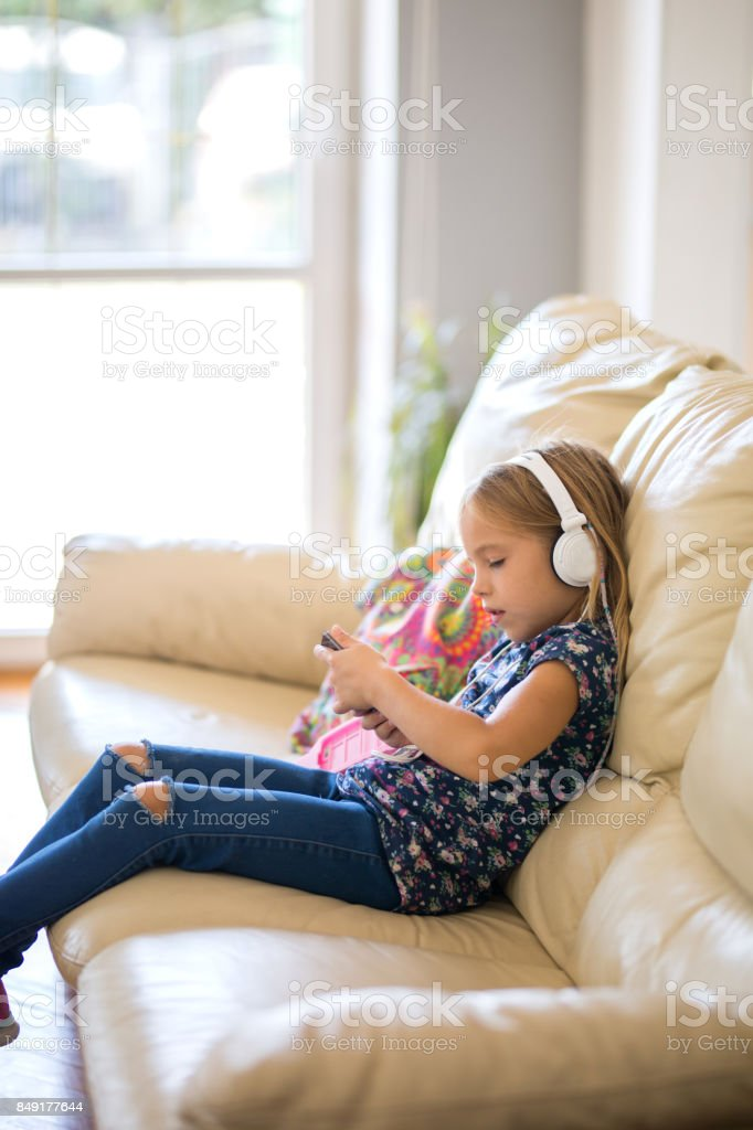 Smiling Girl Listening To Mp3 Player Stock Photo - Download Image Now