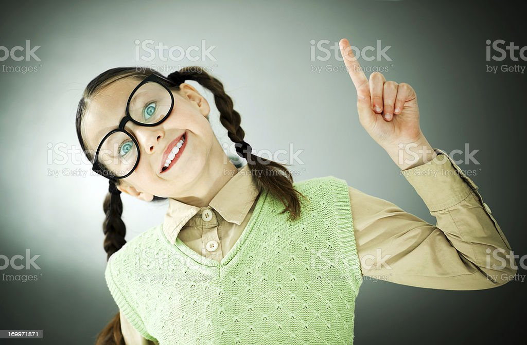 Smiling girl nerd looking at the camera. stock photo