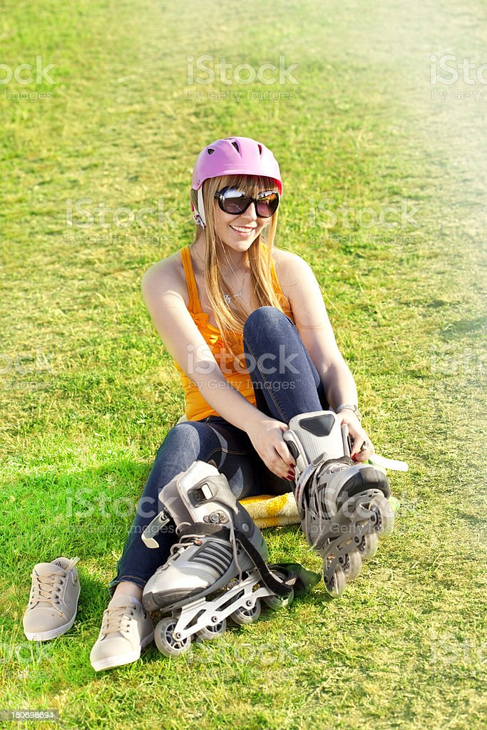 Smiling Girl on a roller skate royalty-free stock photo