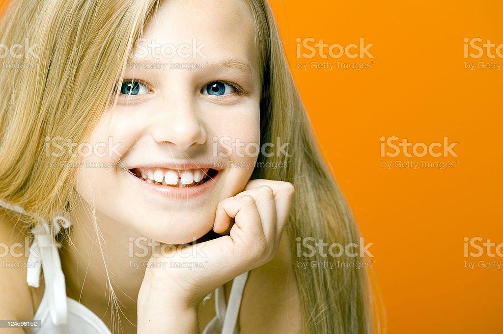 Smiling Girl On Orange stock photo