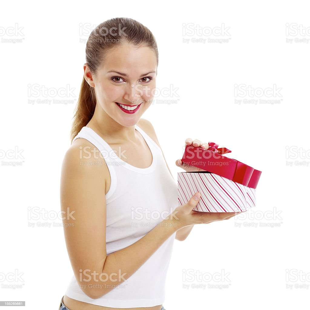 Smiling girl opens gift royalty-free stock photo