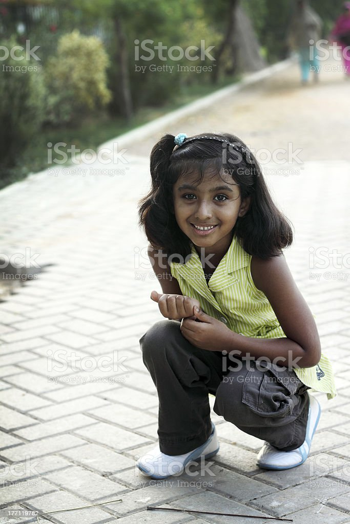 Smiling Girl Playing in the park stock photo