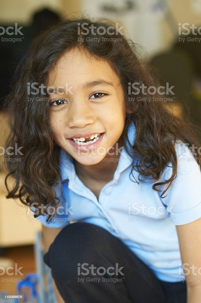 Smiling girl showing gap in teeth stock photo
