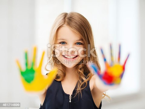 istock smiling girl showing painted hands 461214699