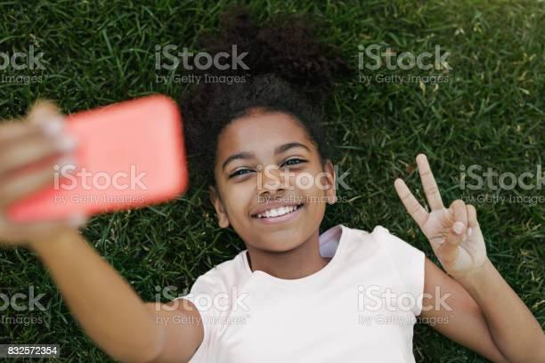 Smiling girl taking selfie on her smartphone picture id832572354?b=1&k=6&m=832572354&s=612x612&h=pbiyqrp0 hr4yqc9telbtdkk1tnkdm d3oqpc1qhbrs=
