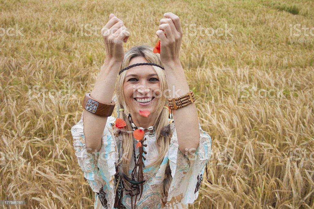 Smiling girl throwing poppy petals stock photo