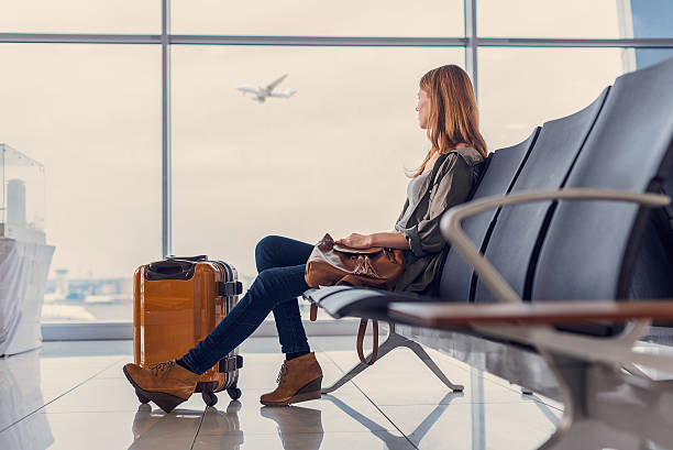 Smiling girl waiting for boarding stock photo