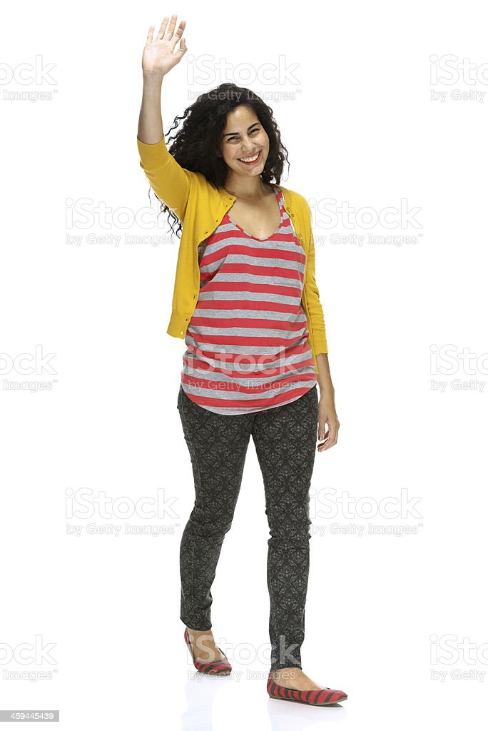 Smiling girl waving her hand stock photo