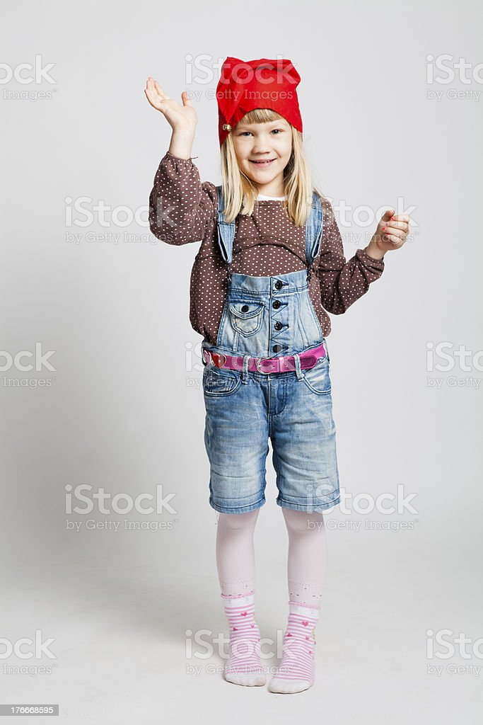 Smiling girl wearing Christmas hat and waving royalty-free stock photo