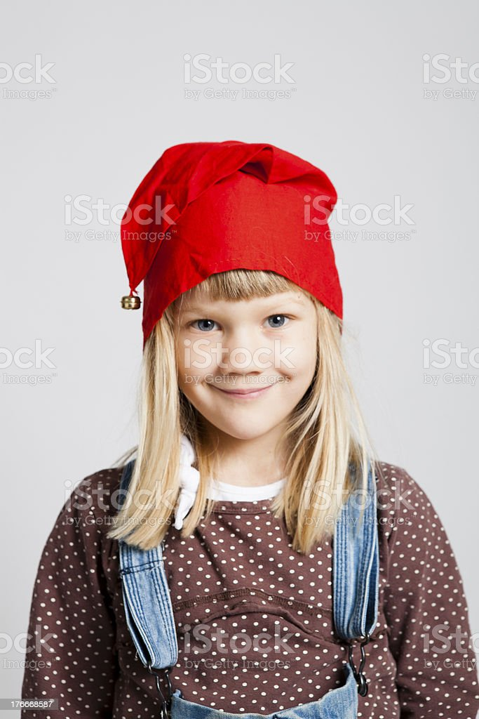 Smiling girl wearing Christmas hat royalty-free stock photo