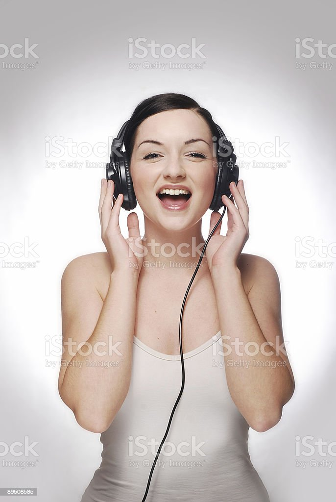 Smiling girl wearing headphones royalty-free stock photo