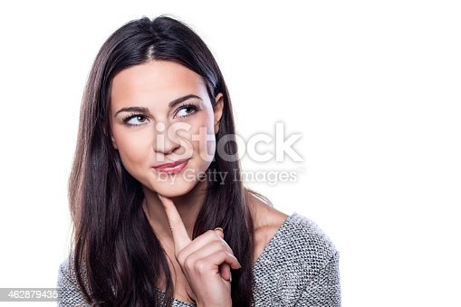 istock Smiling girl with a finger to her chin 462879435