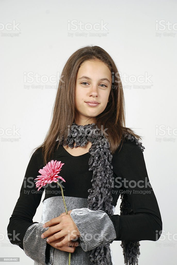 Smiling girl with a flower royalty-free stock photo