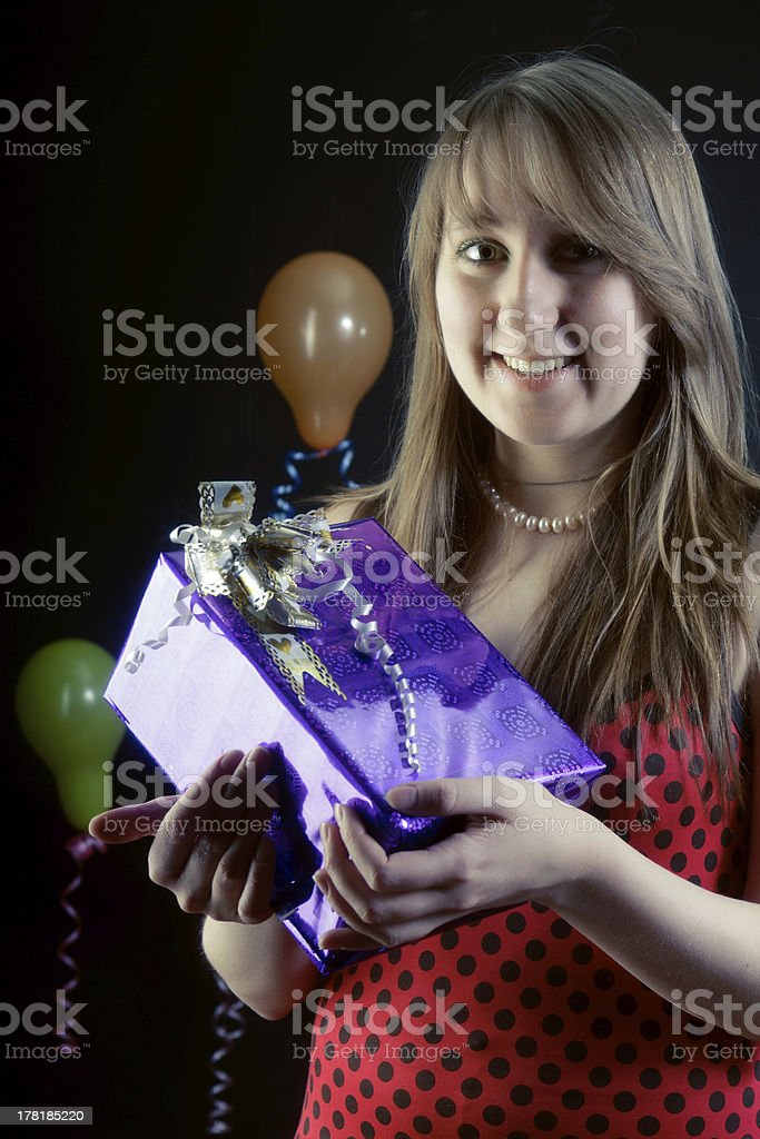 smiling girl with a gift box royalty-free stock photo