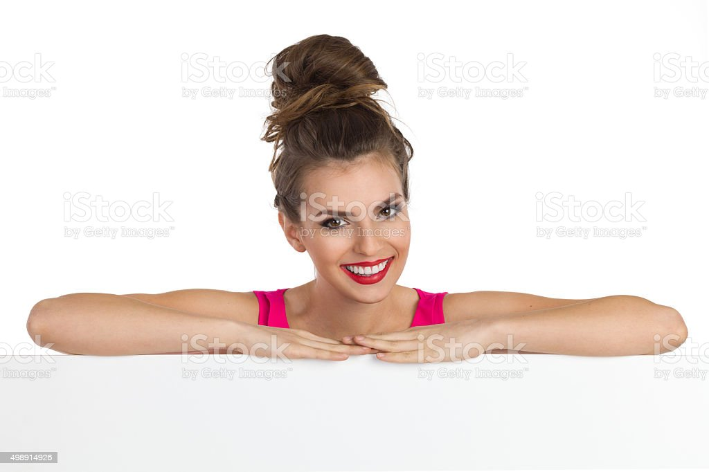 Smiling Girl With A Topknot stock photo