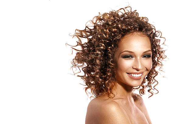 smiling girl with afro hairstyle stock photo
