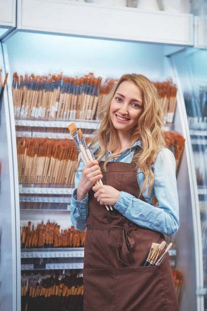 Smiling girl with an art brush stock photo