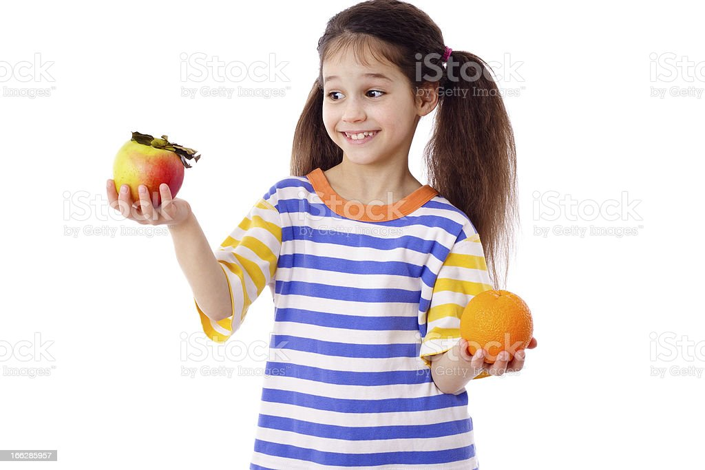 Smiling girl with apple and orange royalty-free stock photo
